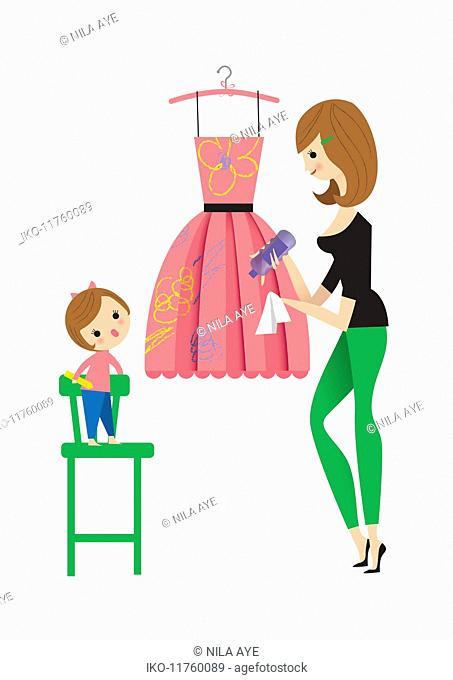 Mother cleaning daughter's crayon scribbles off smart dress