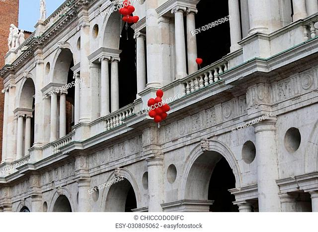 Ancient Palace called BASILICA PALLADIANA with colorful balloons during the Festival in VICENZA in Italy