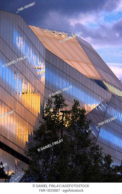 One New Change, an ultra-modern building in London, England, at dusk on a stormy evening