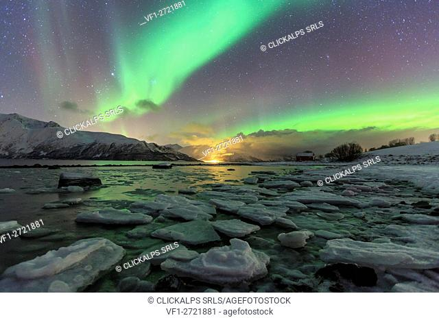 The Northern Lights illuminates the icy landscape in Svensby Lyngen Alps Tromsø Lapland Norway Europe