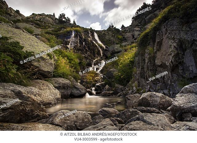 Hiking up to the Juclar lake, small waterfall of the Juclar river, pyrenees mountain range, Andorra
