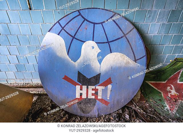 """Old Soviet peace sign with """"""""no"""""""" word on a bomb in abandoned Jupiter Factory in Pripyat city of Chernobyl Zone of Alienation in Ukraine"""