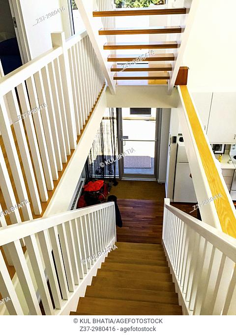 A modern design interior with straight stairs and white paint, Canada