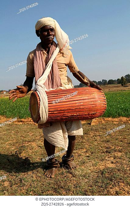 Tribal Musician playing drums, KHAIRWAR TRIBE, Chiniya village, Dist Balrampur, Chattisgarh, India
