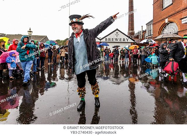 A Lone Morris Dancer Entertains The Crowd In The Rain During The 'Dancing In The Old' Event Held In The Yard Of Harvey's Brewery, Lewes, Sussex, UK