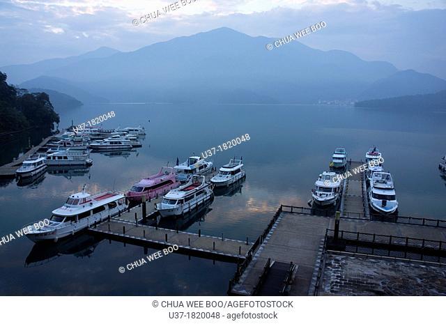 The early morning view of cruise boats anchored at Sun Moon Lake, Taiwan