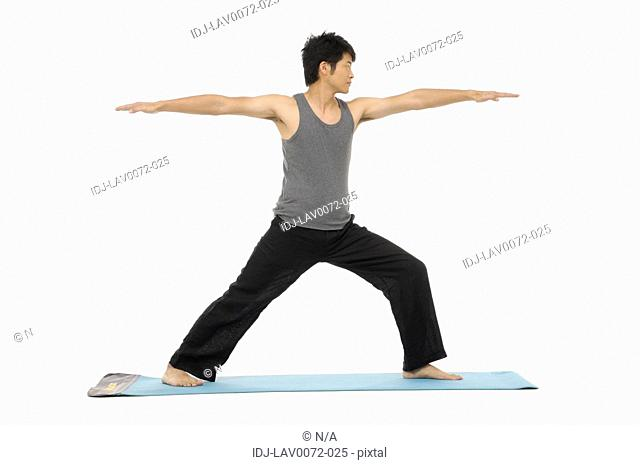 young man doing yoga on Exercise Mat