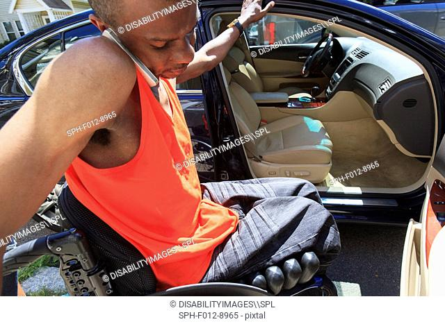 Man who had spinal meningitis entering automobile from his wheelchair while on mobile phone