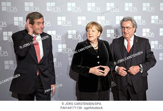 New president of the Confederation of German Employers' Associations (BDA, L-R), Ingo Kramer, German Chancellor Angela Merkel (CDU) and former president of the...