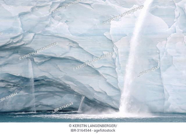 Meltwater waterfalls at the glacier front of Bråsvellbreen, the longest glacier front in the northern hemisphere