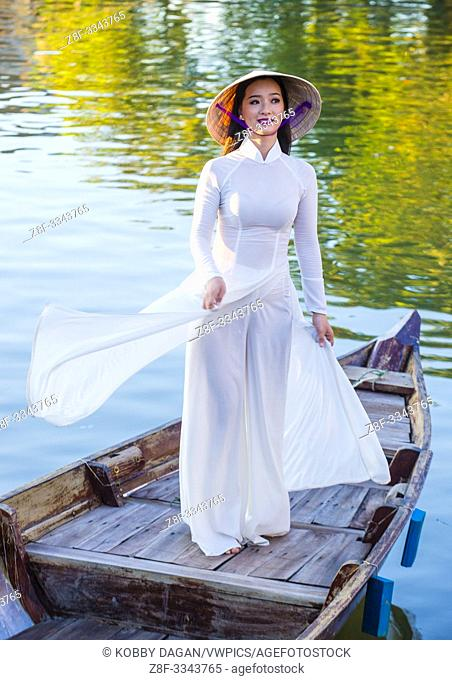 Vietnamese woman wearing Ao Dai dress during the Mid autumn festiaval in Hoi An Vietnam