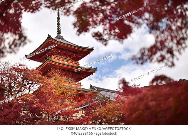 Sanjunoto pagoda of Kiyomizu-dera Buddhist temple in Kyoto framed by red autumn leaves. Higashiyama, Kyoto, Japan