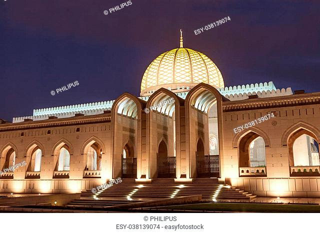 The Sultan Qaboos Grand Mosque illuminated at dusk. Muscat, Sultanate of Oman, Middle East