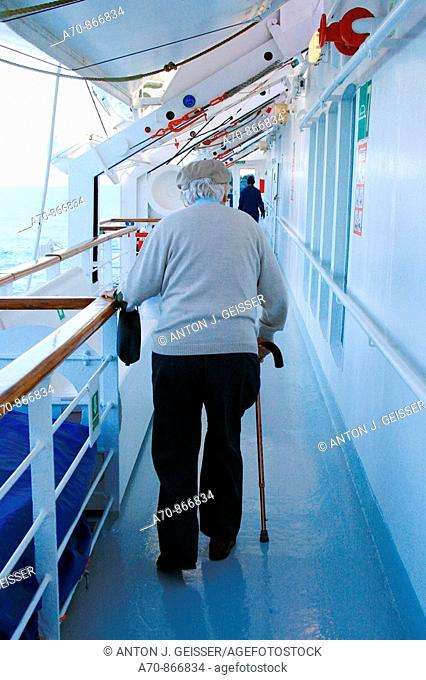 Senior with going stick on cruise ship Coral, Louis Cruise LINEs