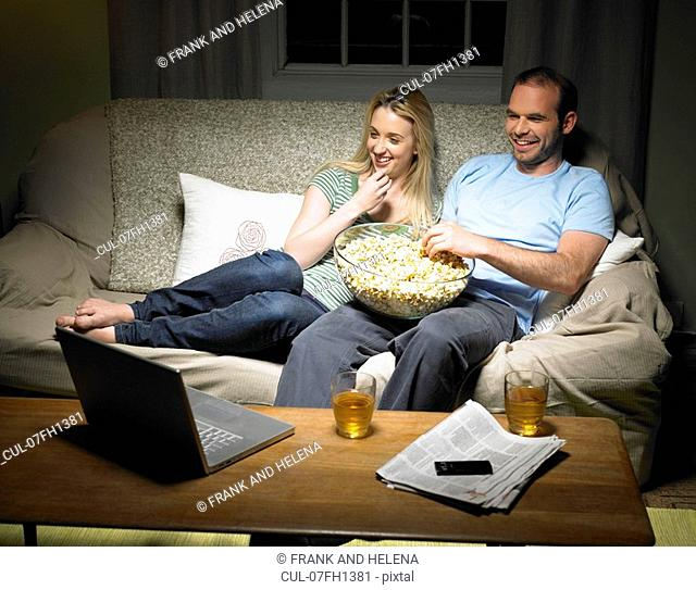Young couple watching a movie