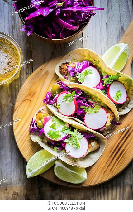 Taco shells with chicken and radishes (Mexico)