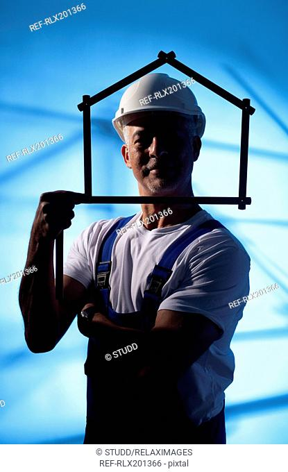 Construction worker folding ruler house shape man