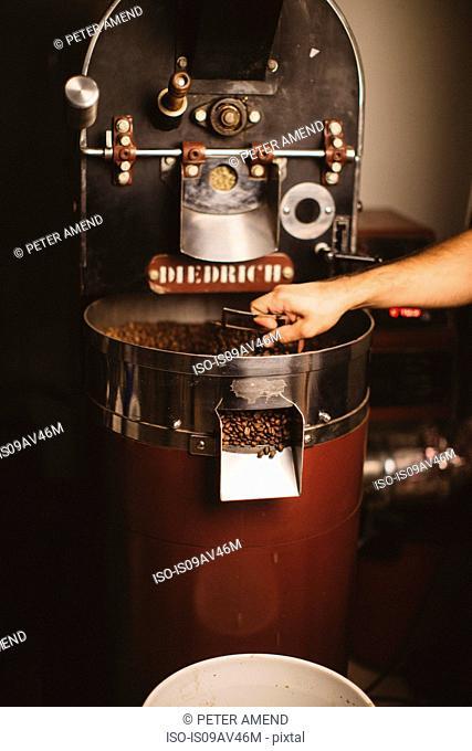 Man using coffee roaster