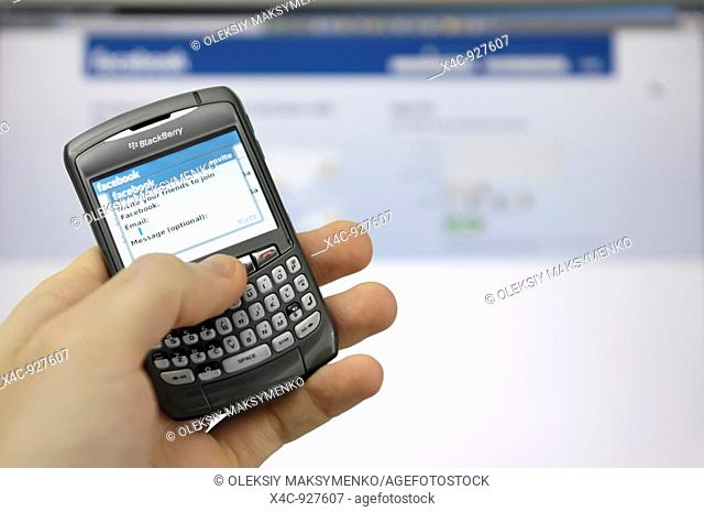 Facebook invitation screen on a display of Blackberry smartphone