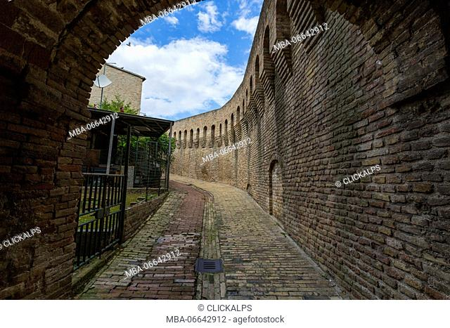 A typical alley and medieval walls of the old town of Corinaldo Province of Ancona Marche Italy Europe