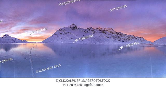 Overview from the frozen surface of Lake Bianco at the Bernina Pass at sunrise. Canton of Graubunden. Engadine. Switzerland. Europe