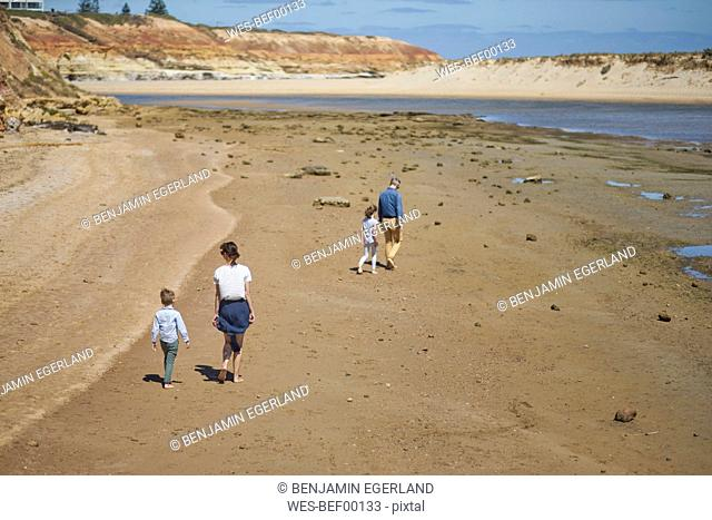 Australia, Adelaide, Onkaparinga River, family walking on the beach together