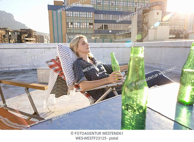 Young woman relaxing on her terrace
