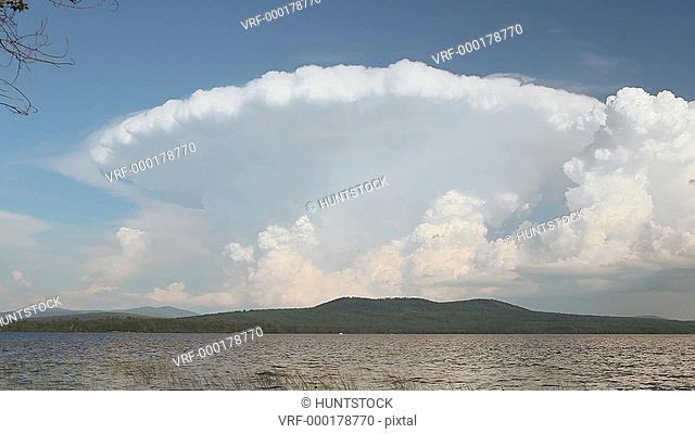 Cumulonimbus clouds over a lake, Lake Umbagog, New Hampshire, USA