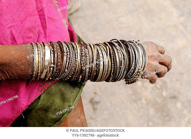 old lady's hand with a collection of bracelets , kathmandu, nepal