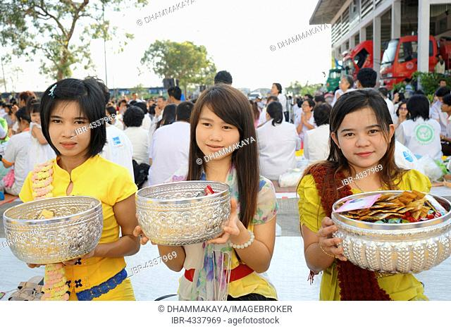Young women collect donations at the Bigboon pilgrims' procession, meditation day of the Dhammakaya Foundation, Dawei, Tanintharyi Region, Myanmar
