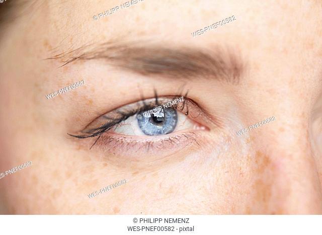Woman's blue eye, close-up
