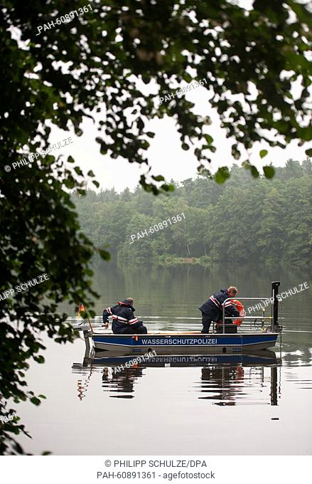 Police forces are using a boat with a sonar device during the search for a missing mother and her daughter in Buchholz in der Nordheide, Germany, 19 August 2015