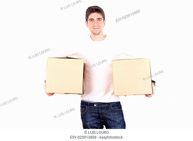 Handsome young man with cardboard boxes unpacking in new home