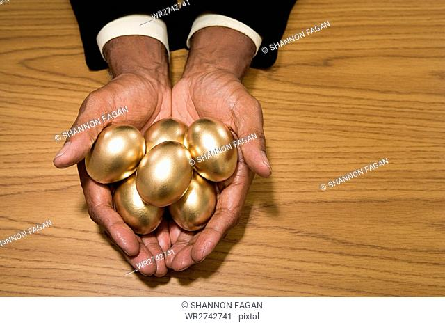 Man holding golden eggs