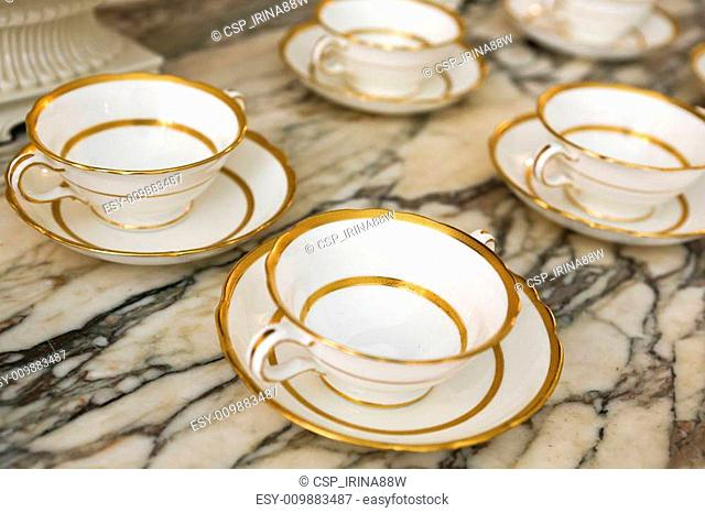 Antique white china cups with plates