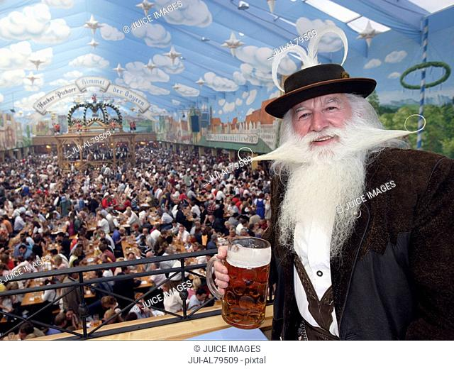 Large crowd enjoying food and drinks at festival in Munich