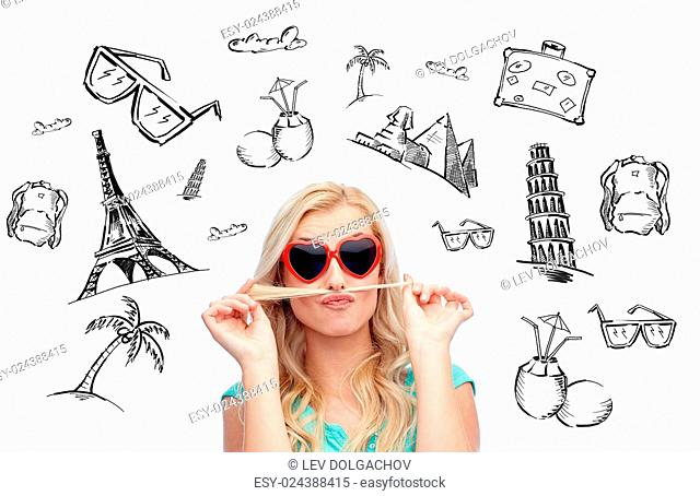 people, tourism, vacation and summer holidays concept - smiling young woman or teenage girl making mustache with strand of hair over touristic doodles