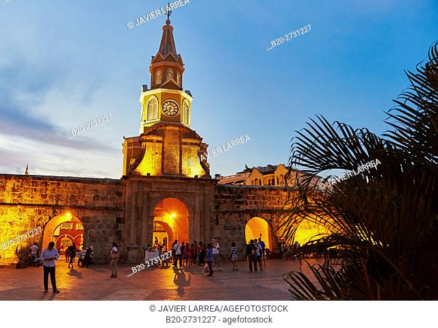 Colombia, Bolivar, Cartagena de Indias, Illuminated cathedral with clock tower at dusk