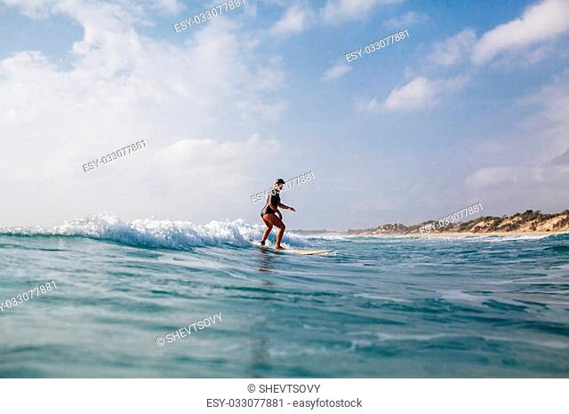 surfing woman with surfing board back view