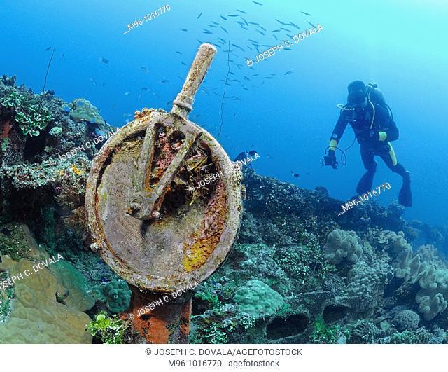 Scuba diver looks at telegraph on deck of Japanese shipwreck Fujikawa Maru, Chuuk, Micronesia, Pacific