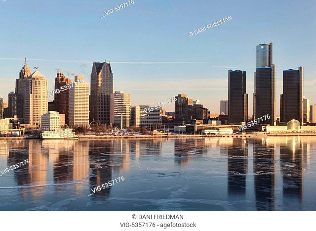 The skyline of Detroit, Michigan, USA with a thin sheet of ice on the Detroit River seen just after sunrise. Detroit's population has sunk to 700