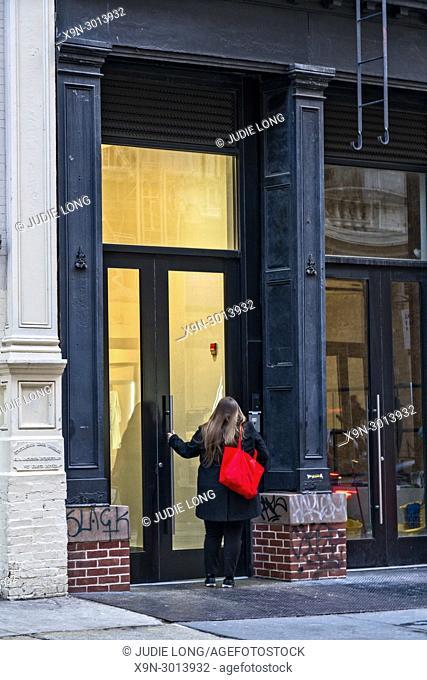 Woman , Causacian, 20-30, Using Building Intercom to Gain Entry into a Manhattan, NYC, Soho Building