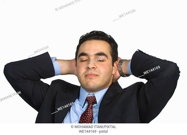 Businessman sleeping resting hands behind head