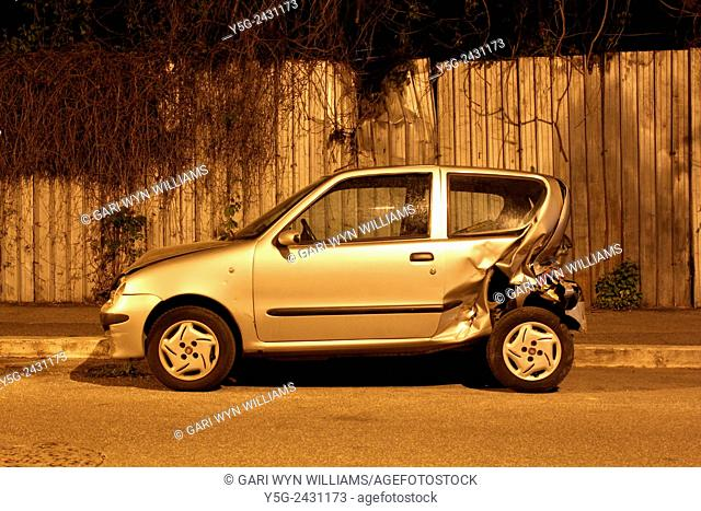 Car damaged in an accident in street at night in Rome Italy