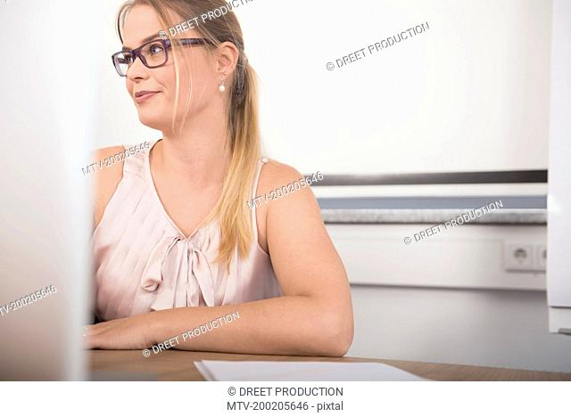 Portrait woman young office glasses blond working