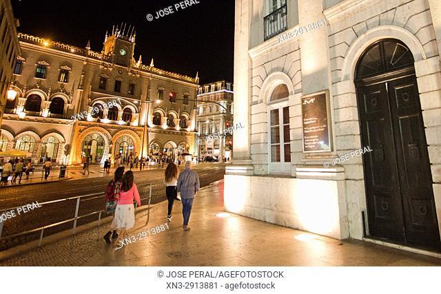 At right National Theatre Dona Maria II, on background Main entrance, Rossio Railway Station, Estação de Caminhos de Ferro do Rossio, Lisbon, Portugal, Europe