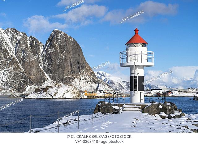 Lighthouse with Festheltinden peak and the village in the background. Reine, Nordland county, Northern Norway region, Norway