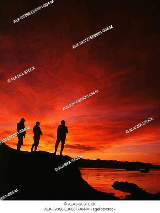 Silhouette of People Hiking Near Lynn Canal SE Alaska Summer Scenic