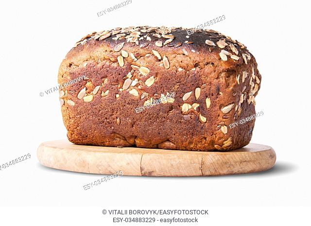 Unleavened bread with seeds and dried fruit on wooden board isolated on white background