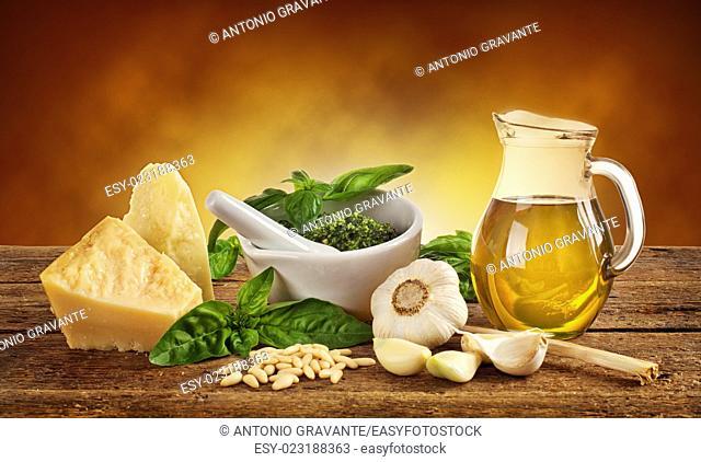 Genovese pesto ingredients on wooden table